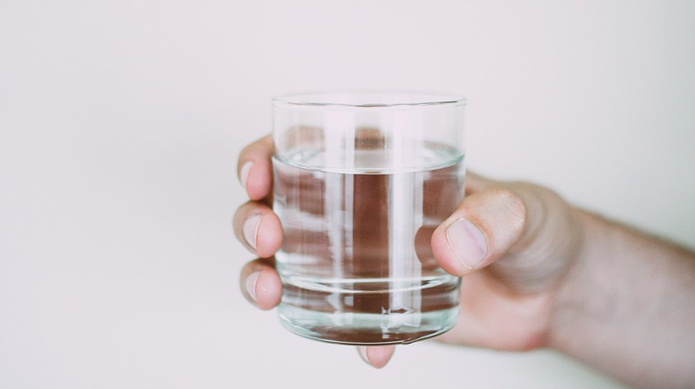 Your Qs: Does drinking water with meals impact digestion?
